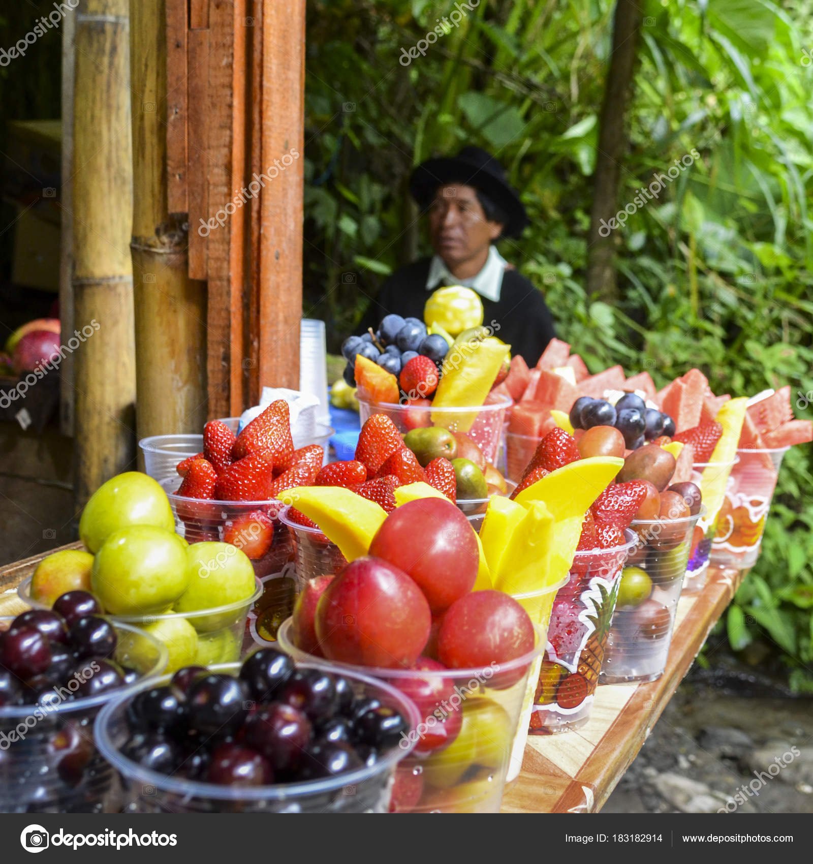 Local tropical fruits for sale with indigenous Ecuadorian man in