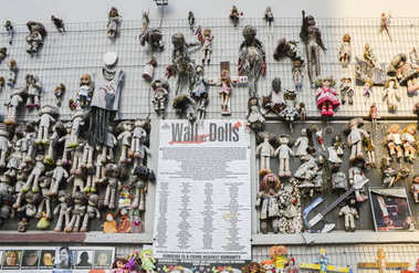 Wall of Dolls protest in Navigli district protesting against female physical and sexual violence, throughout the world