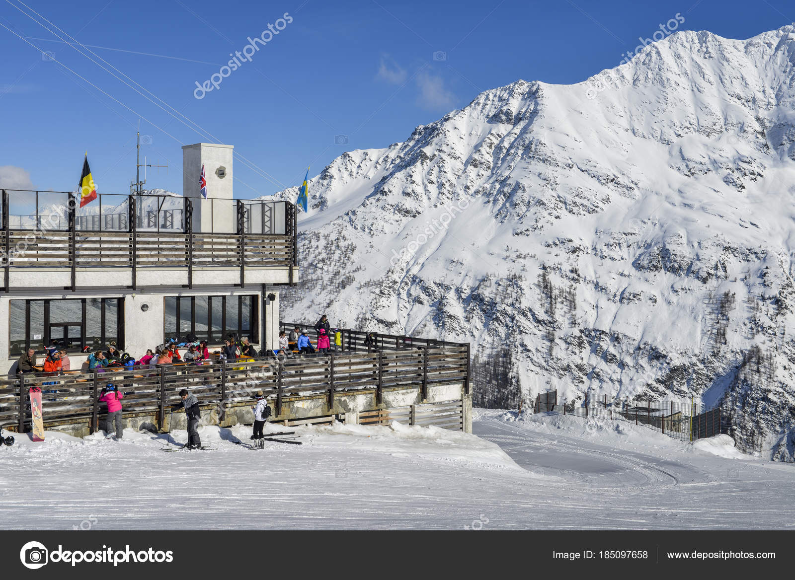 skiers and snowboarders with their gear at la thuile ski resort in