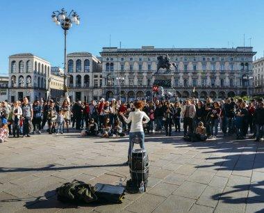 A sole violin street performer at Milan's Piazza del Duomo