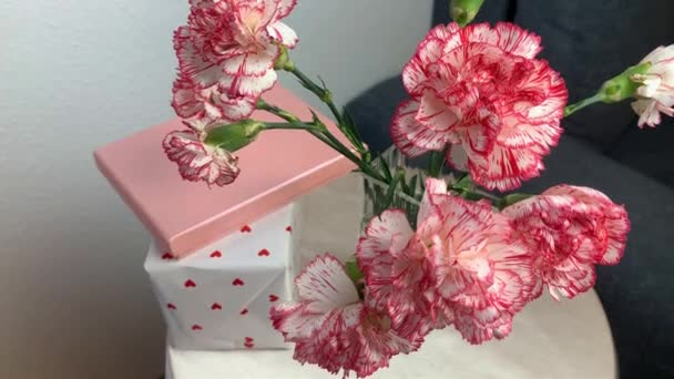 bouquet of pink flowers of carnations is standing in a vase, concept of sweet home