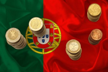 metal currency coins against the background of the national flag of portugal country, concept of financial development, devaluation, inflation, taxes
