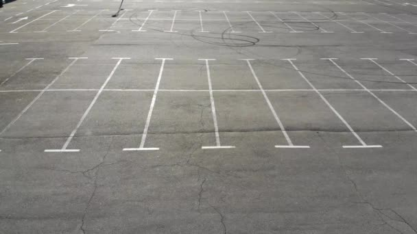 Aerial drone shot of the empty parking lot of a supermarket due to Corona virus pandemic