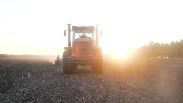 Rural work land by agriculture equipment or tractor at sunset field, nature farm