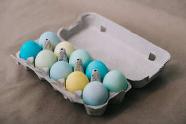 multi-colored easter eggs in cardboard pack