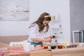 Fotografie stylish little child painting easter eggs