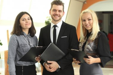 close up.businessman and staff standing in creative office