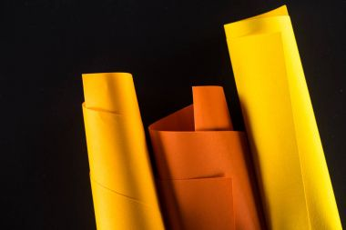 rolled color papers isolated on black