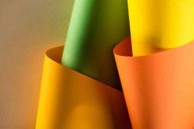 Close-up shot of rolled colorful papers for background stock vector