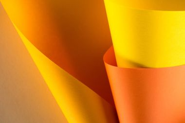 close-up shot of rolled orange and yellow papers for background