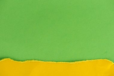 Close-up shot of green and yellow paper layers for background stock vector