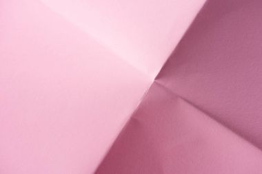 Close-up shot of folded pink paper for background stock vector