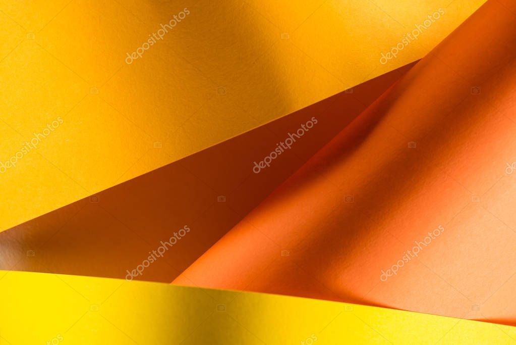 close-up shot of orange and yellow colored papers for background