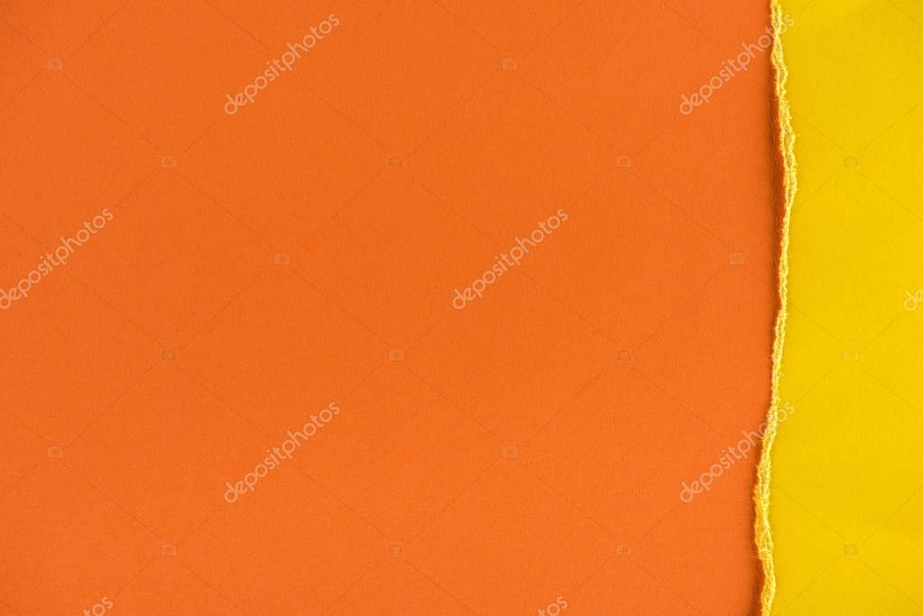 close-up shot of orange and yellow paper layers for background