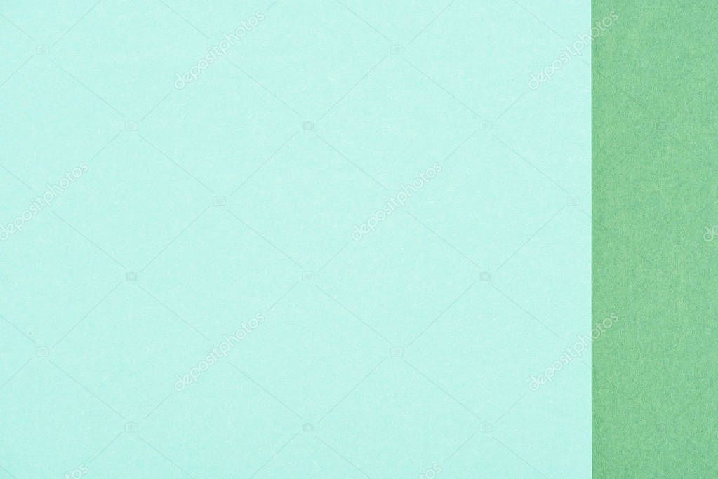 close-up shot of cyan and emerald green paper layers for background