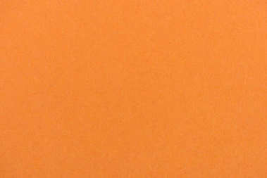 texture of orange color paper as background