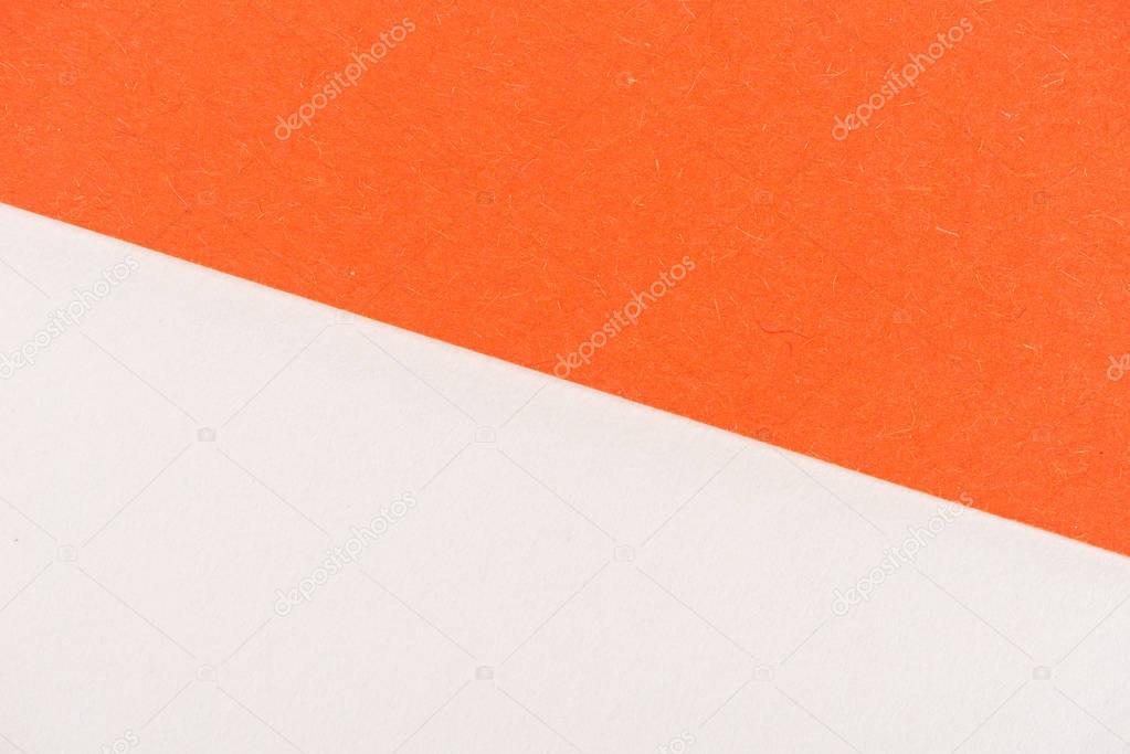 close-up shot of orange and white paper layers for background