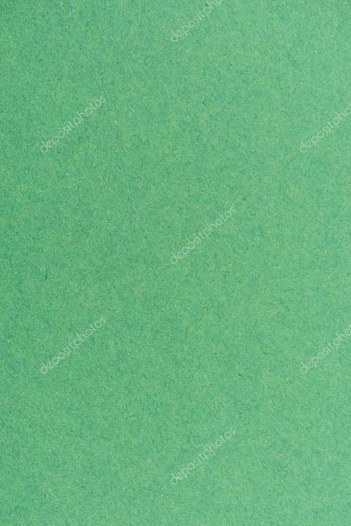 texture of green color paper as background