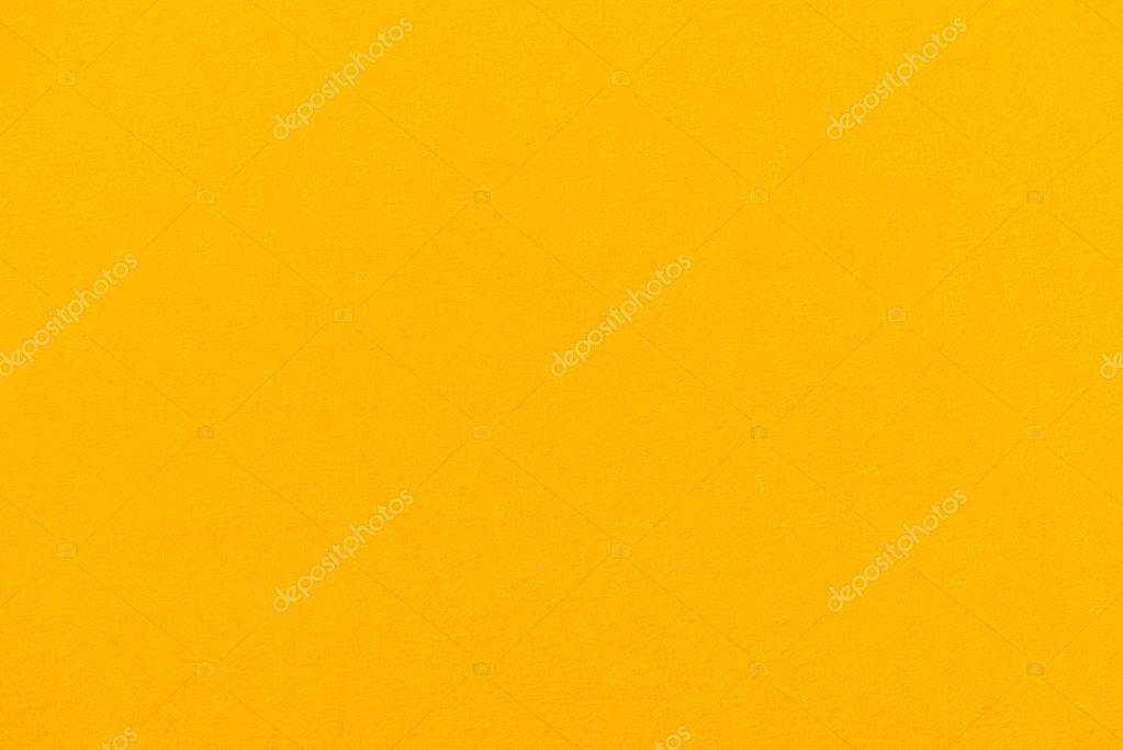 texture of yellow color paper as background