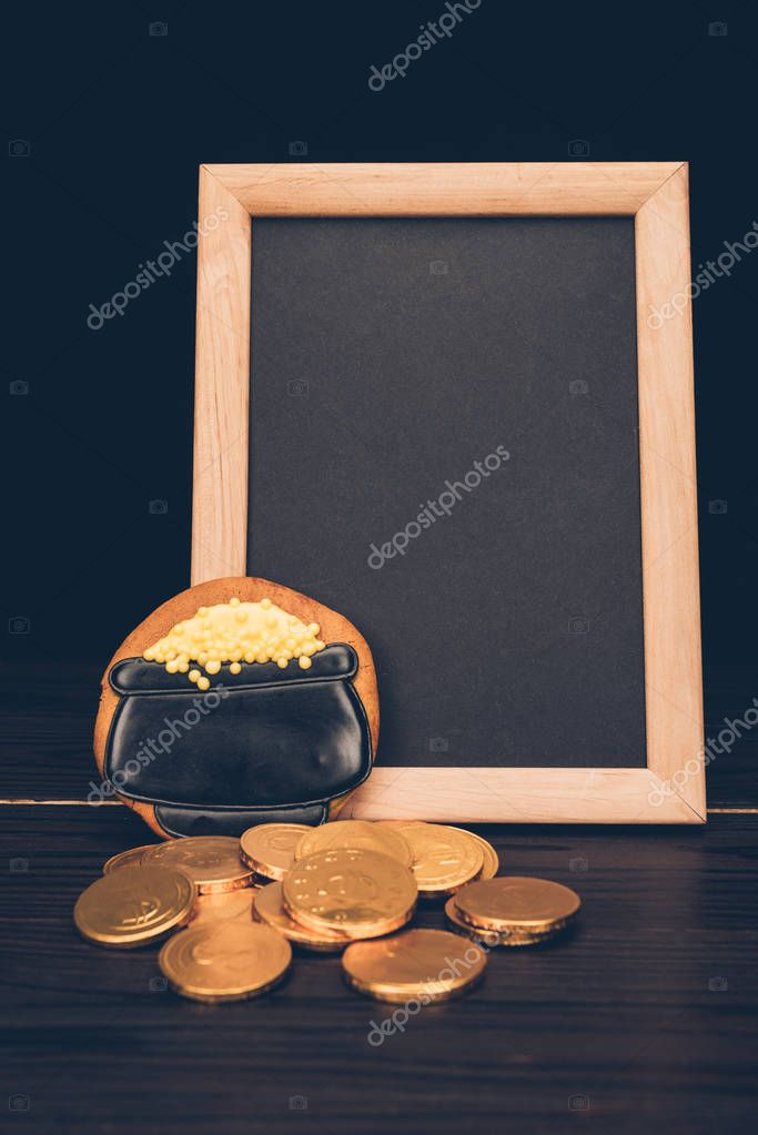empty board with golden coins and gingerbread, st patricks day concept