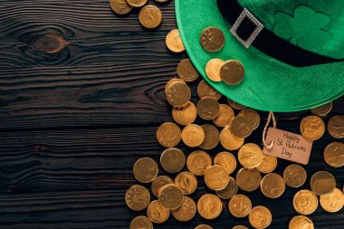 top view of green hat and golden coins, st patricks day concept
