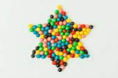 Photo top view of star made of sweets isolated on grey, purim holiday concept