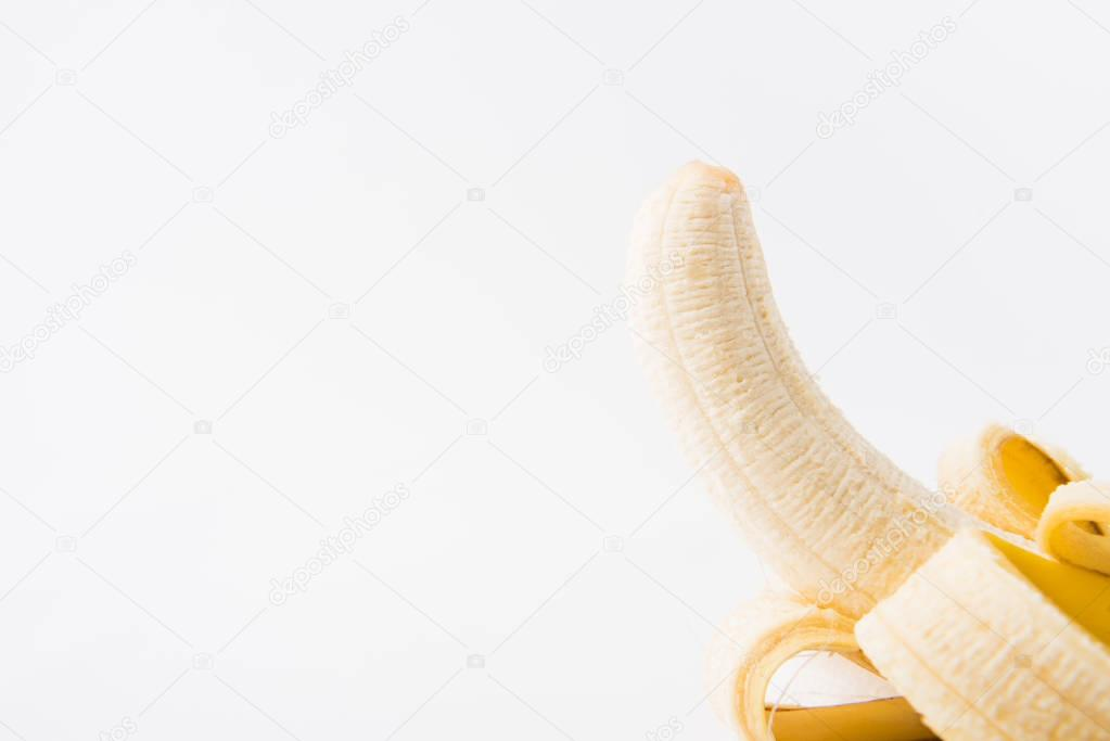 raw peeled banana isolated on white background