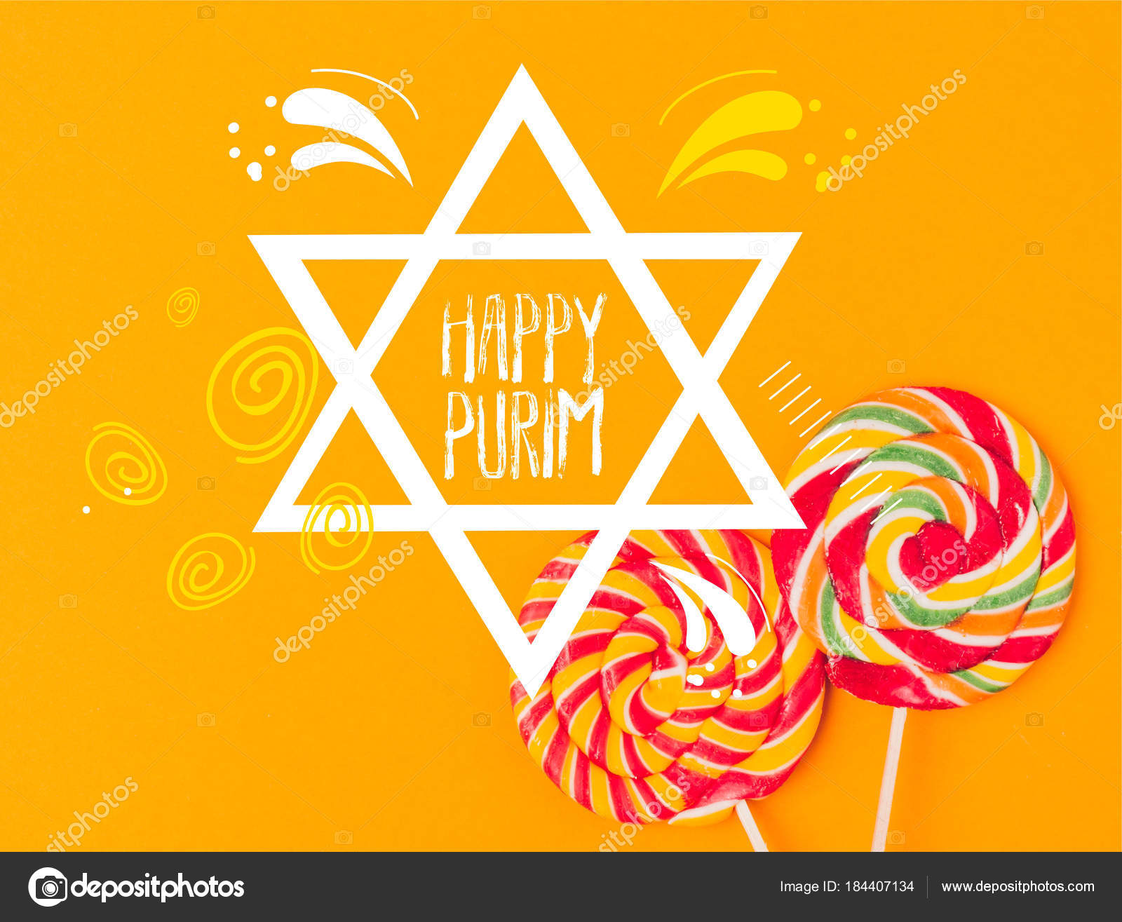 """ID: a white magen David on a golden yellow background says """"Happy Purim"""". There are two large round lollipops in the lower right hand corner."""