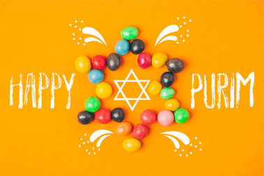 top view of star made of sweets isolated on orange, purim holiday concept