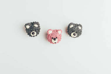 top view of sweet tasty cakes in shape of bears isolated on grey