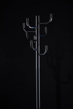 empty coat stand isolated on black