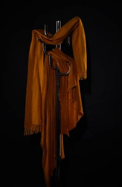 clothes hanging on coat rack isolated on black