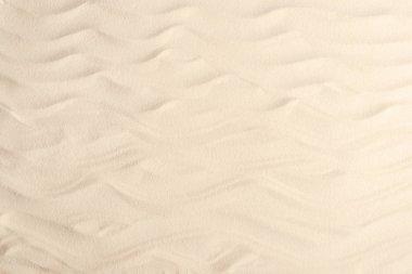 Waves on light sand for summer travel background