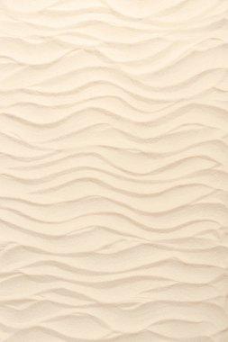 Wavy sandy beach texture for summer travel background