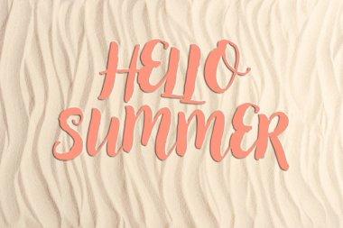 Hello summer inscription on sandy beach