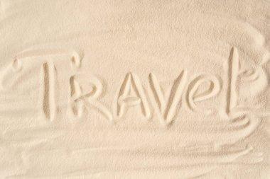Travel inscription on summer sandy beach
