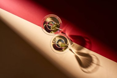 Top view of martini cocktails on red and beige background