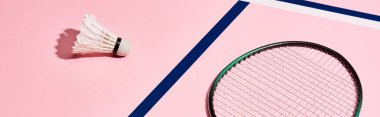 Badminton racket and shuttlecock on pink background with blue lines, panoramic shot stock vector