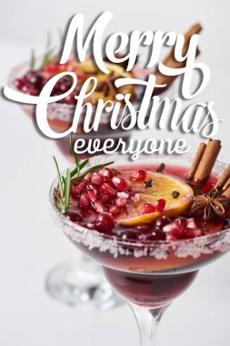 Selective focus of christmas cocktail with orange, pomegranate, cinnamon with merry christmas everyone illustration stock vector