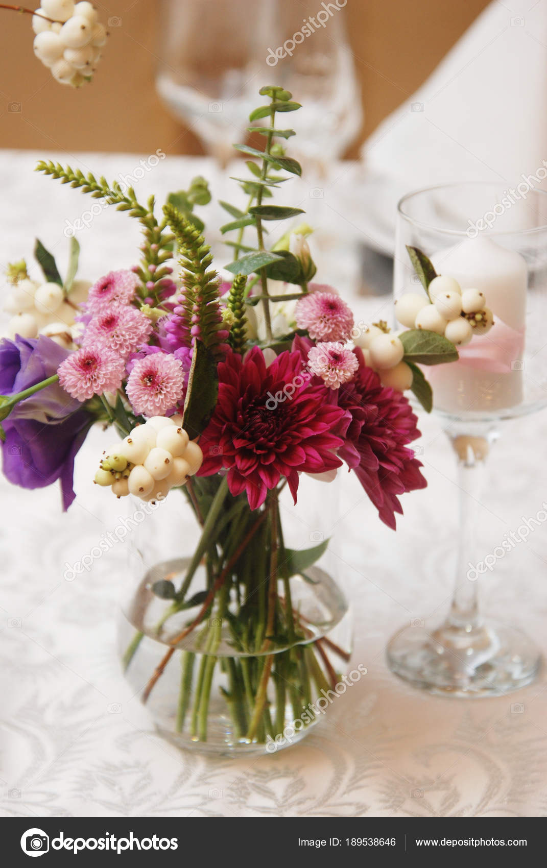 Beautiful Pink Flowers In Glass Vase On Wedding Table Flower