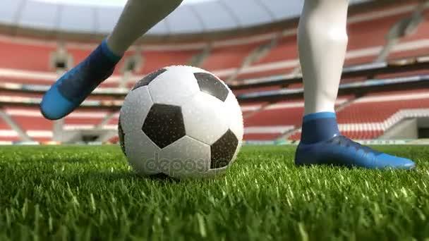 részlet futball játékos rúgja a labdát, a mező lassított 4k