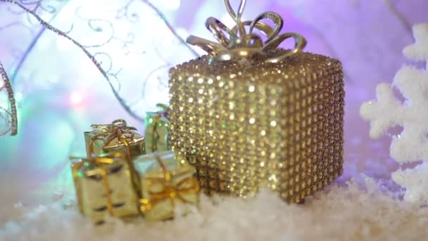 Golden Christmas gift border with decorative luxury gifts over a textured gold background