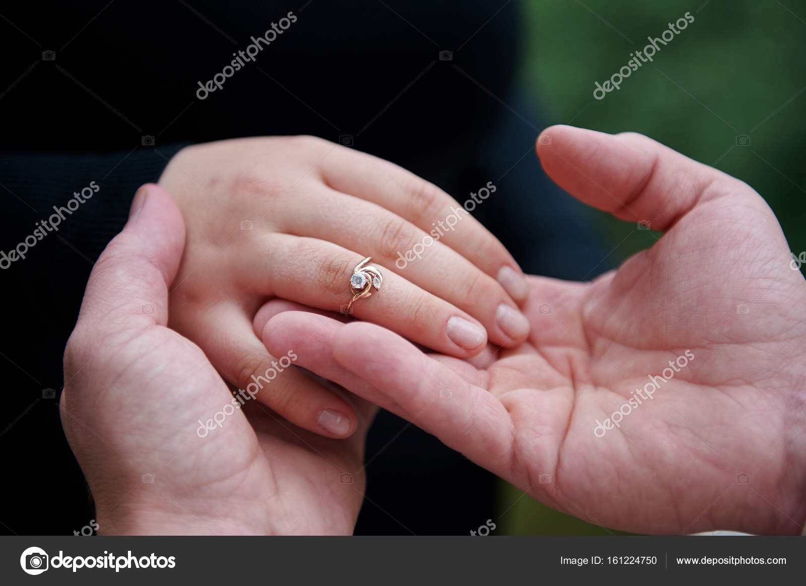 Man dresses an engagement ring on a woman finger — Stock Photo ...