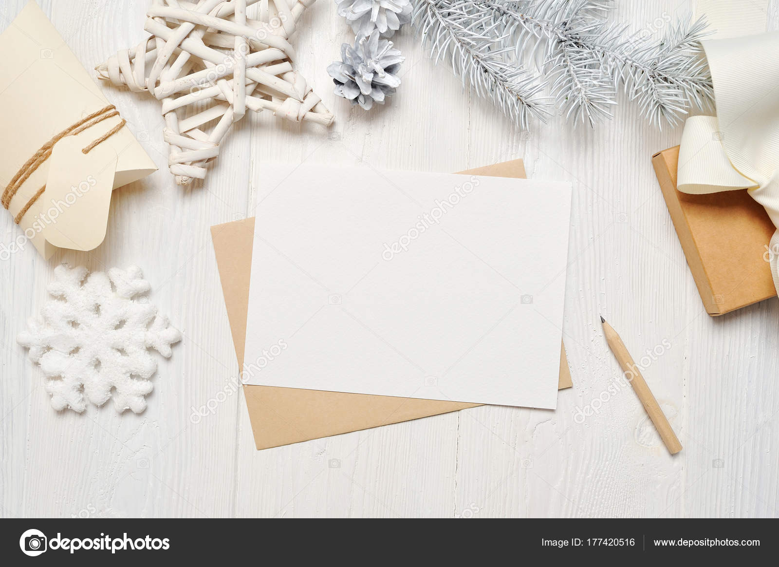 Mockup christmas greeting card letter in envelope with white tree mockup christmas greeting card letter in envelope with white tree flatlay on a white wooden m4hsunfo