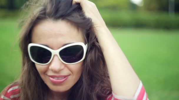 woman in sunglasses on summer field. Makeup Smiling Beauty