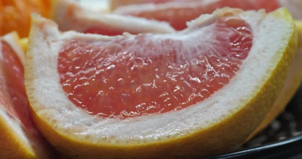 Pink citrus fruit cuts. fresh pink grapefruit fruits slices. Closeup. Selective soft focus. Fruits background. concept of healthy natural products and eating