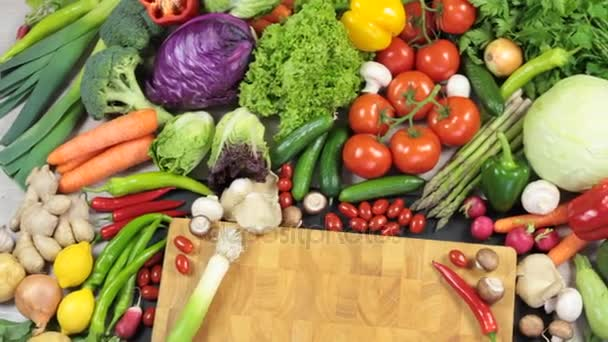 Fresh vegetables and chopping board