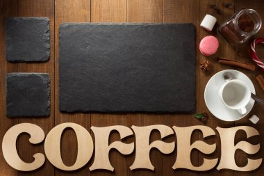 cup of coffee and letters on wood