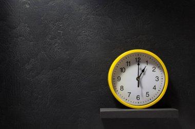 wall clock  at black background