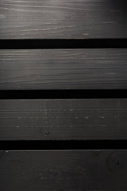 boards on black wall